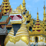 Large lion guardian statues at Shwedagon pagoda Royalty Free Stock Images