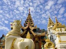 Large lion guardian statues at Shwedagon pagoda Stock Photo