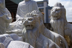 Large lion statues. Carved from marble, Hoi An, Vietnam royalty free stock images