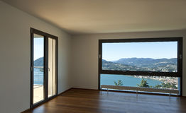 Large living room with panoramic view. Modern apartment, large living room with panoramic view Royalty Free Stock Images