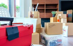 Living room with moving boxes. Large living room with stack of moving boxes stock photos