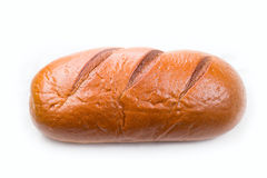 Large loaf of bread isolated on white Stock Images