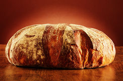 Large loaf of traditionally baked bread on the table Royalty Free Stock Photos