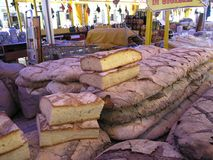 Large loafs of bread in market. Stack of large loafs on bread for sale in Italian market stock photo