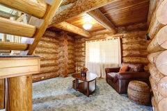 Large log cabin house interior - cozy Sitting room royalty free stock images