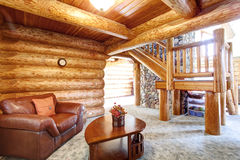 Large log cabin house interior - cozy Sitting room royalty free stock photography