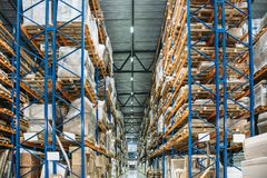 Large Logistics hangar warehouse with lots shelves or racks with pallets of goods stock photos