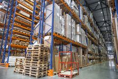 Large Logistics hangar warehouse with lots shelves or racks with pallets of goods. Industrial shipping and cargo delivery stock photography