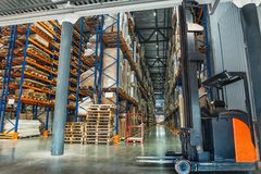 Large Logistics hangar warehouse with lots shelves or racks with pallets of goods. Industrial shipping and cargo delivery. Distribution concept stock image