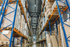 Large Logistics hangar warehouse with lots shelves or racks with pallets of goods. Industrial shipping and cargo delivery. Distribution concept stock photos
