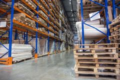 Large Logistics hangar warehouse with lots shelves or racks with pallets of goods. Industrial shipping and cargo delivery royalty free stock image