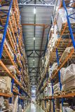 Large Logistics hangar warehouse with lots shelves or racks with pallets of goods. Industrial shipping and cargo delivery. Distribution concept, vertical image stock photo