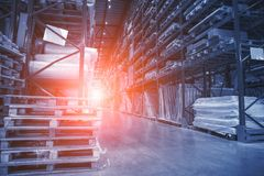 Large Logistics hangar warehouse with lots shelves or racks with pallets of goods. Industrial shipping and cargo delivery, toned stock photos