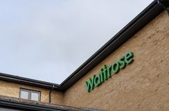 Signage of a large, well-known groceries and supermarket chain in the UK. stock images