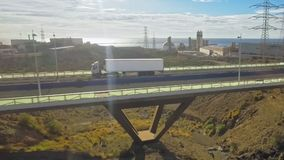 A large and long truck carries cargo stock video