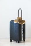 Large Luggage And Wicker Hat On Wooden Background. Royalty Free Stock Image