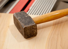 Large lump hammer on workbench Stock Photo