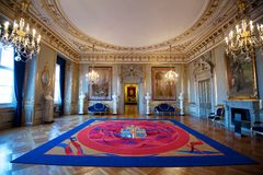 Large luxurious room and carpet. Large room with elaborate ceiling in the Christiansborg Palace Stock Photography