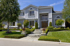 Large Luxurious Suburban Home For The Executive With A Family. Exterior shot of a recently constructed home that shows great attention to detail in it's design Stock Image