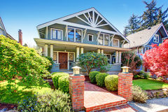 Large luxury blue craftsman classic American house exterior. royalty free stock images