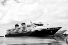 Large luxury cruise ship Disney Wonder on sea water and cloudy s. Nassau, Bahamas-January 15, 2016: Large luxury cruise ship Disney Wonder on sea water and Royalty Free Stock Photo