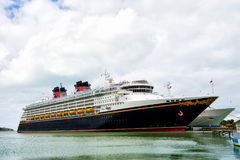 Large luxury cruise ship Disney Wonder on sea water and cloudy sky background docked at port of Nassau, Bahamas. Nassau, Bahamas-January 15, 2016: Large luxury Royalty Free Stock Image