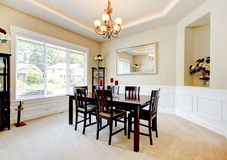 Large luxury dining room with dark wood furniture. Stock Photo