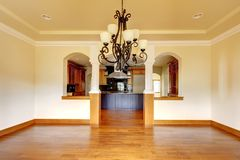 Large luxury dining room interior with kitchen and arch. Stock Photos