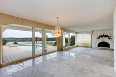 Large luxury empty living room with white marble floor, large wi Royalty Free Stock Image