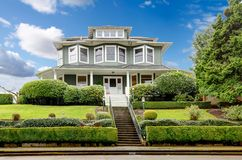 Large luxury green craftsman classic American house exterior. Stock Photography