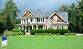 Large luxury home for sale. Exterior of a large, well-kept luxury home with porch for sale Stock Images