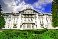 Large Luxury Hotel. View of a large, white, luxury hotel in Sinaia City, Romania Royalty Free Stock Images