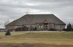 Large luxury house in cloudy weather. View of the private homes and cottages in Winnipeg before the Halloween Photo was taken in November 2013 stock photography