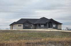 Large luxury house in cloudy weather. View of the private homes and cottages in Winnipeg before the Halloween Photo was taken in November 2013 royalty free stock photo