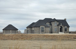 Large luxury house and garage. View of the private homes and cottages in Winnipeg before the Halloween Photo was taken in November 2013 stock images