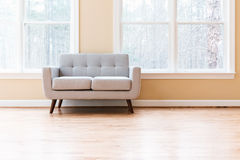 Large luxury interior home with loveseat. Large luxury interior home with gray loveseat Stock Photos