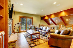 Large luxury living room with leather sofa and TV. Royalty Free Stock Images