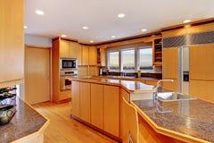 Large luxury modern wood kitchen . Royalty Free Stock Image