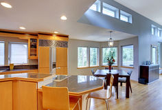 Large luxury modern wood kitchen. With granite counter tops and yellow hardwood floor stock photography