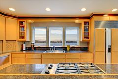Large luxury modern wood kitchen. With granite counter tops and yellow hardwood floor stock images