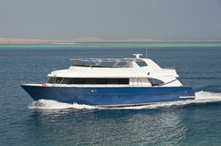 Large luxury motor yacht under way at sea Stock Photography