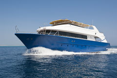 Large luxury motor yacht under way at sea Royalty Free Stock Images