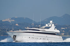 Large luxury private yacht at sea. At sea a large luxury private yacht Royalty Free Stock Photos