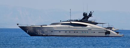 Large luxury private yacht at sea. At sea a large luxury private yacht Royalty Free Stock Photography