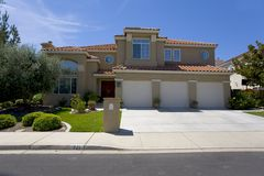 Large Luxury Stucco Home. Exterior shot of a very large stucco home built with luxury Stock Image