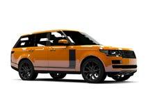 Large luxury SUV orange. Front and side. White Stock Photos