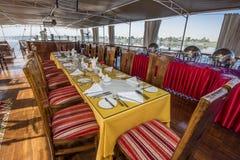 Large egyptian dahabeya river boat sailing on Nile with dining t royalty free stock photo
