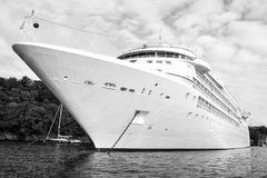 Large luxury white cruise ship liner at Fowey. Cruise ship. Large luxury white cruise ship liner on sea water and cloudy sky background in Fowey Stock Images