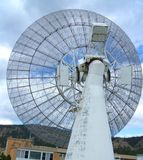 Large 26 m radio telescope at the Dominion Radio Astrophysical Observatory Kaleden BC. Large 26 m radio telescope with hills, clouds and blue sky in background royalty free stock photos