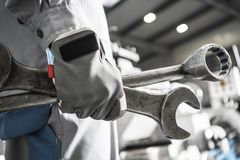 Large Machinery Fixing. Mechanic with Heavy Duty Wrenches in Hand. Closeup Photo royalty free stock images